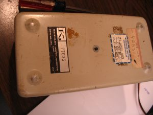 Front of Keithley Megohmmeter, original and before inspection, dirty and covered with stickers.